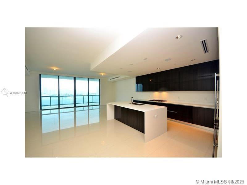 AMAZING UNOBSTRUCTED BAY OCEAN VIEWS, UNIT FEATURES 3 BEDROOMS PLUS SERVICE SUITE, 4 BATH, 1 HALF BA