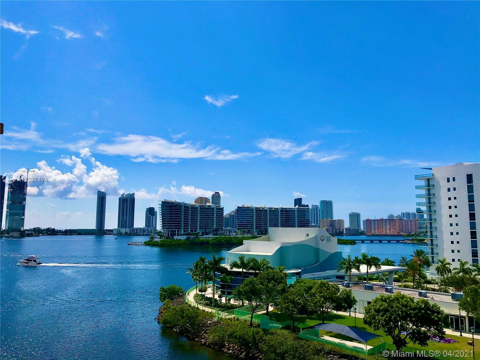 Desirable, corner residence with the most amazing water and Sunny Isles Beach skyline views. Large,