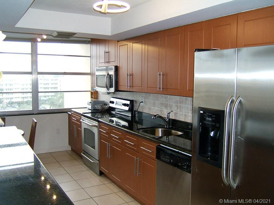 Waterfront remodeled unit. Open kitchen to the living room. Marble countertop. 1565 SF biggest 2 bed