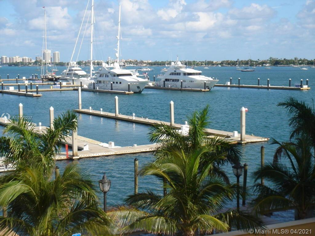 WATERFRONT PARADISE! Breathtaking Intracoastal views from this Luxurious Boutique condo. This end-un