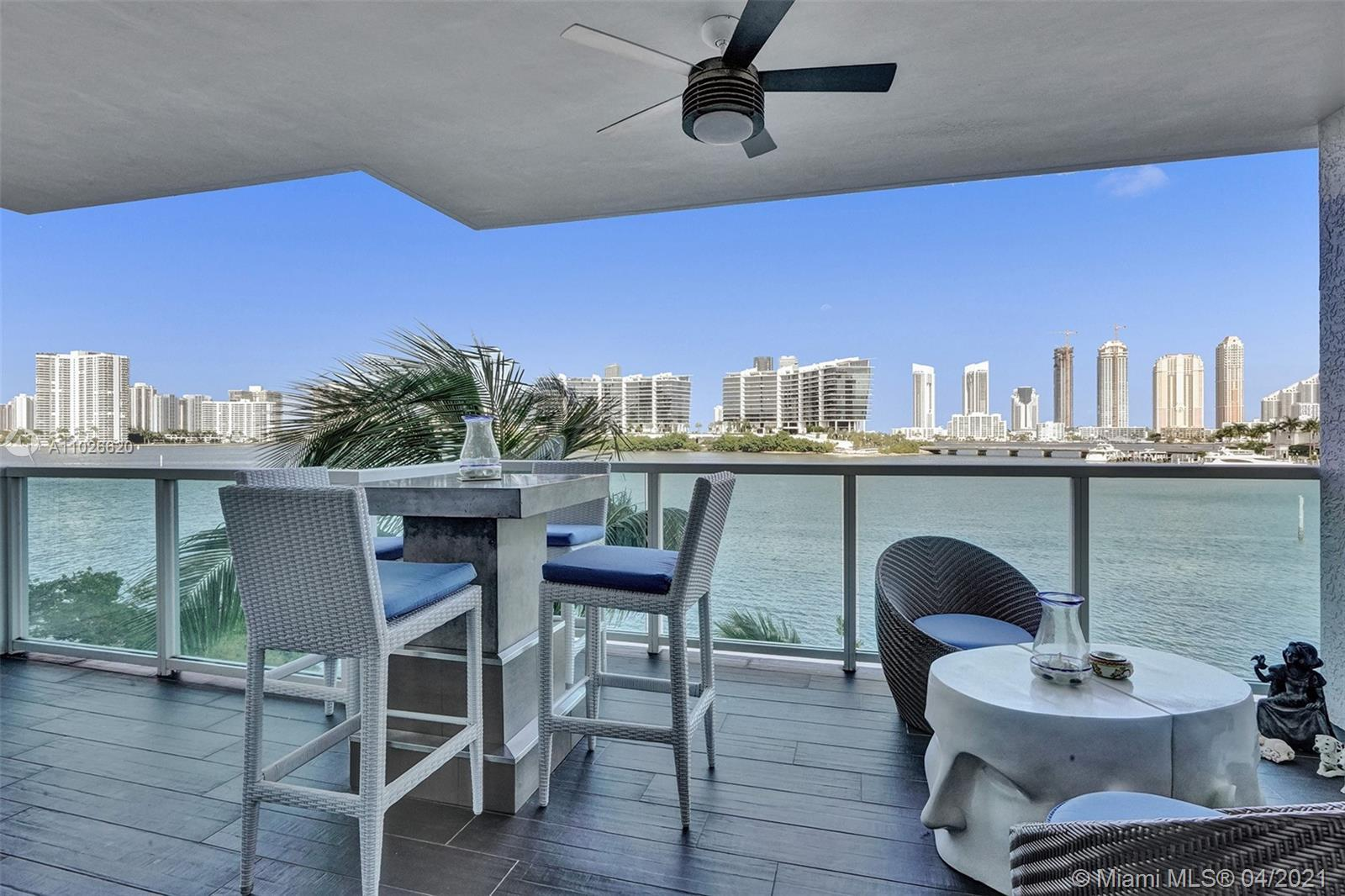 Come home to paradise every day in this waterfront apartment. Step through your dramatic private foy