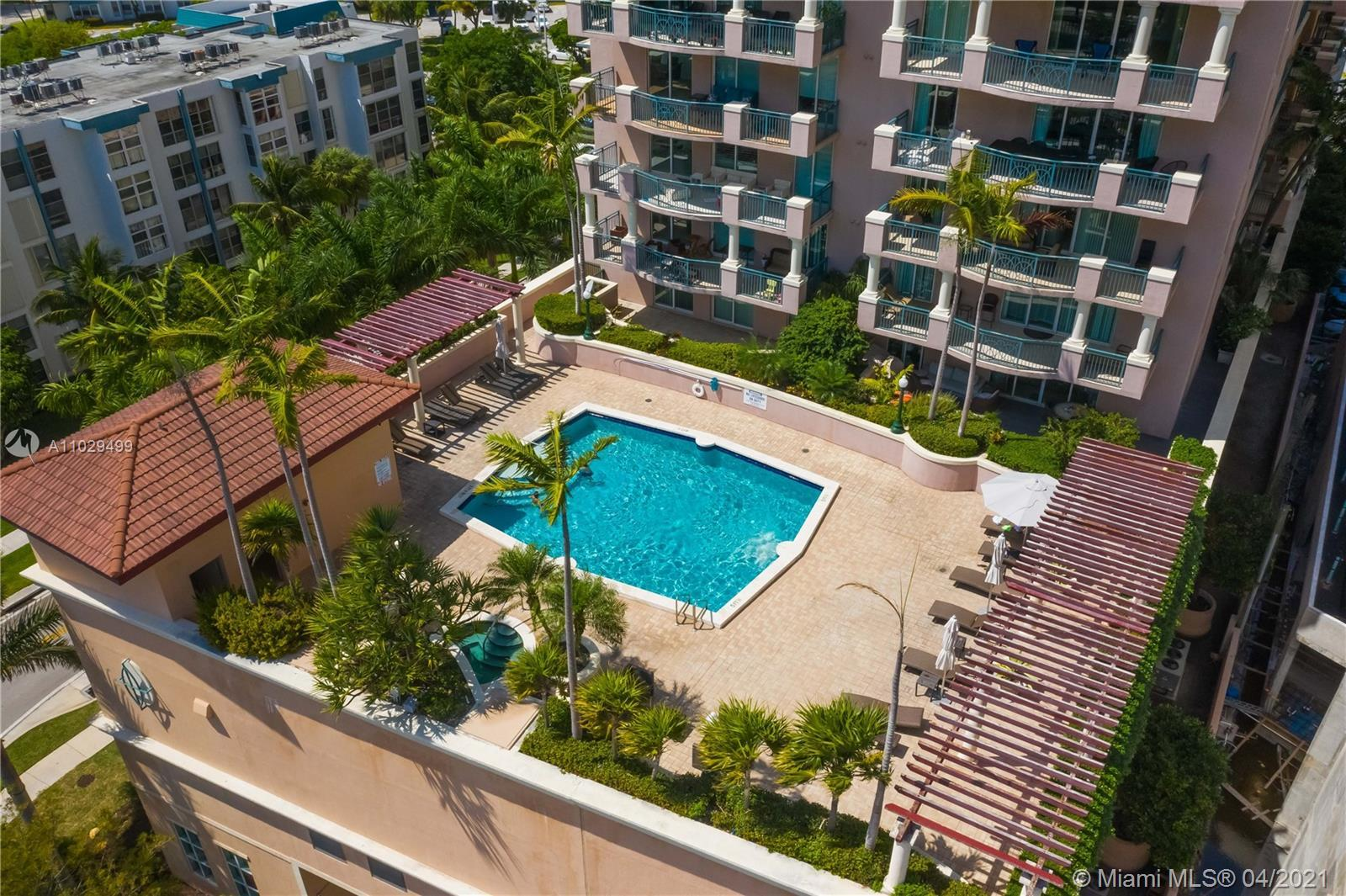 Resort-style residence with amazing amenities! Relax by the sunny pool deck, soak on the hot tub and