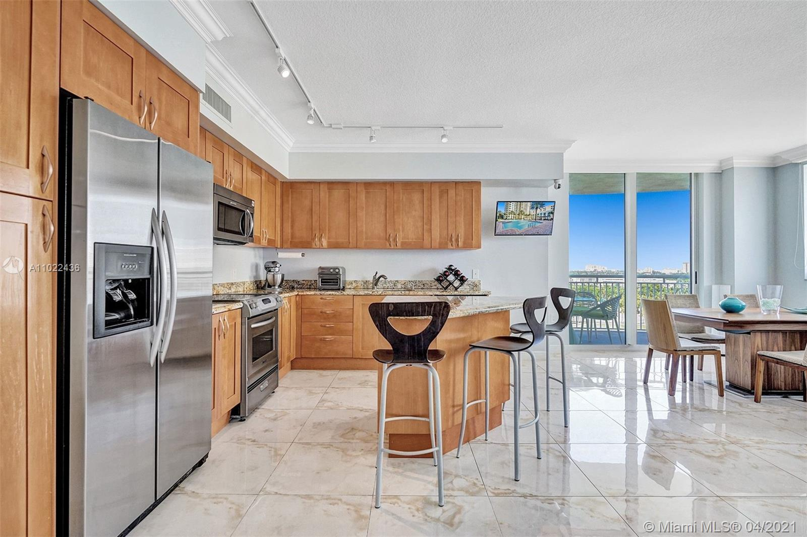 Open and bright 3 bedrooms, 2 baths corner unit at Duo with incredible views of the Diplomat Golf Co