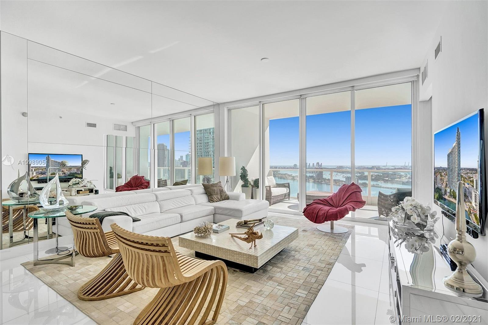 MIAMI RICHES PRESENTS A STUNNING FLOW-THROUGH, FULLY FURNISHED DESIGNER UNIT IN EDGEWATER'S PRESTIGI