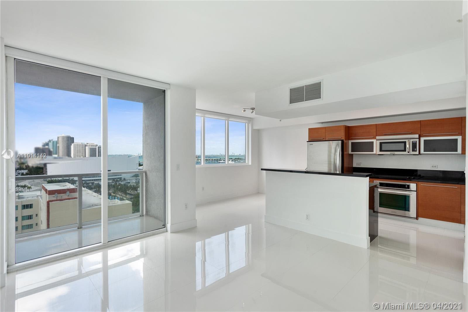 WOW SEE THAT VIEW!!  from this 1 bedroom + enclosed den and 2 full baths. Great location in downtown