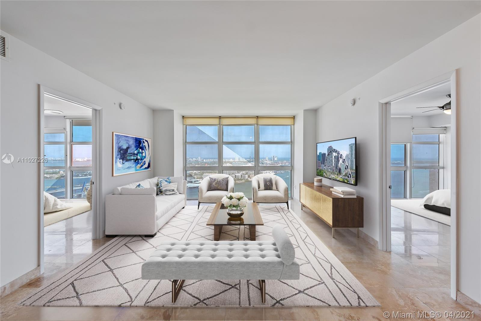 A metropolitan oasis at 50 Biscayne! Residence 4106 features 2 bedrooms + den, 2 baths, travertine f