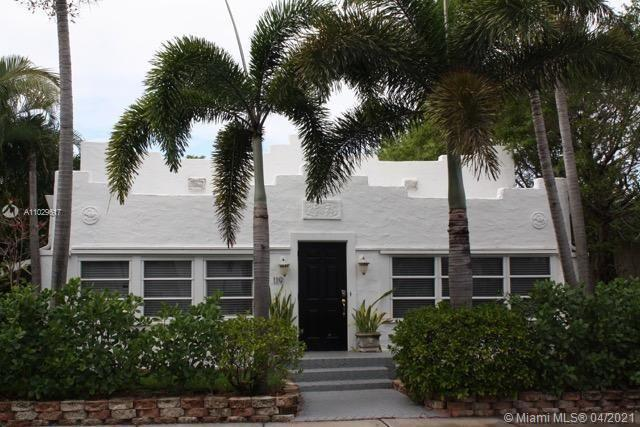 1920's refurbished Spanish Mission style main house with 3 detached income producing renovated guest