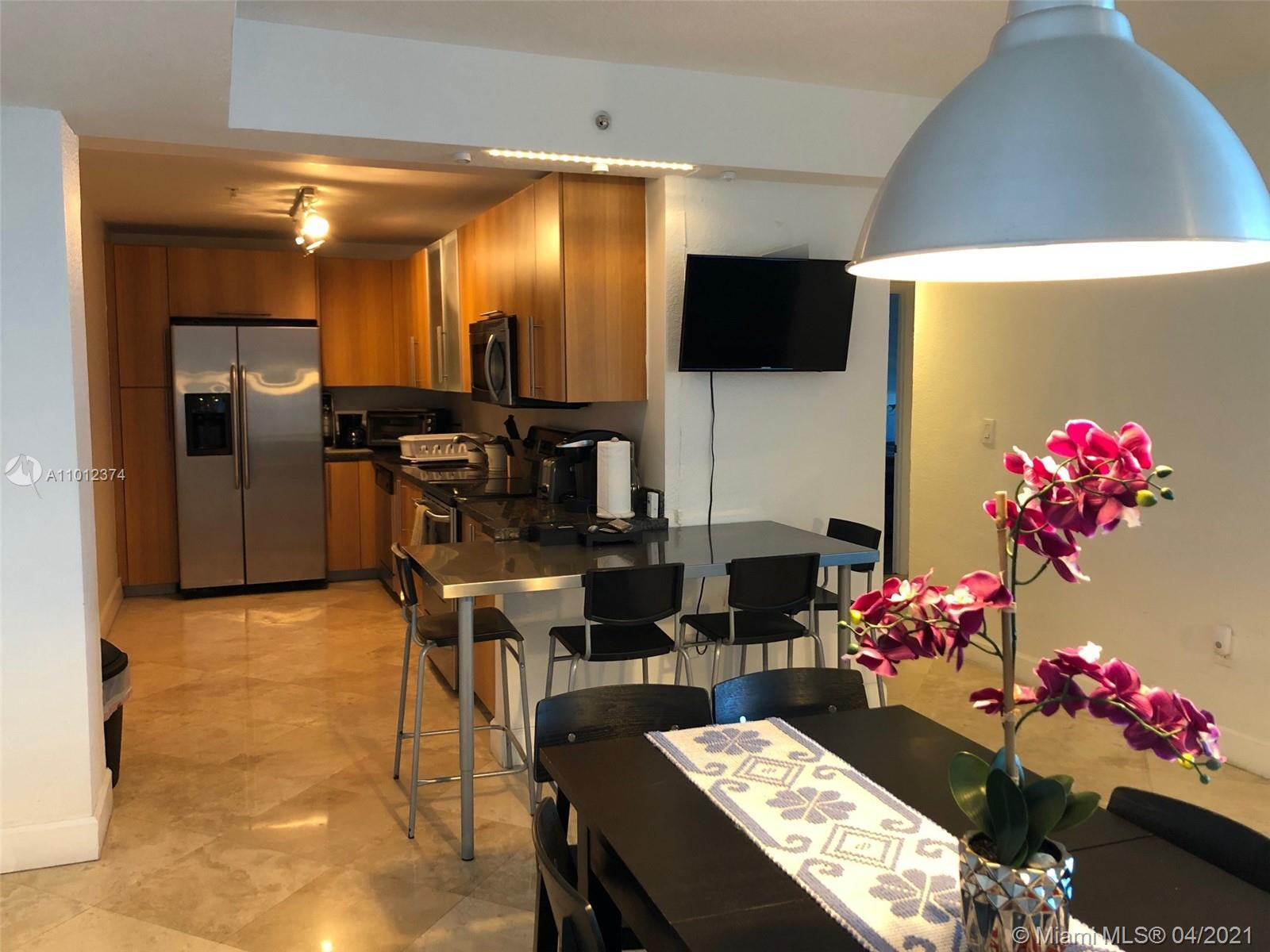 LOCATION! LOCATION! Spacious unit at Treasures on the Bay in the lovely North Bay Village community.
