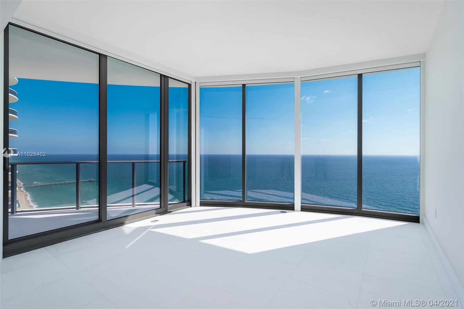 Spectacular wrap around,  This 3 Bed +Den + Staff Room corner residence with floor-to-ceiling glass