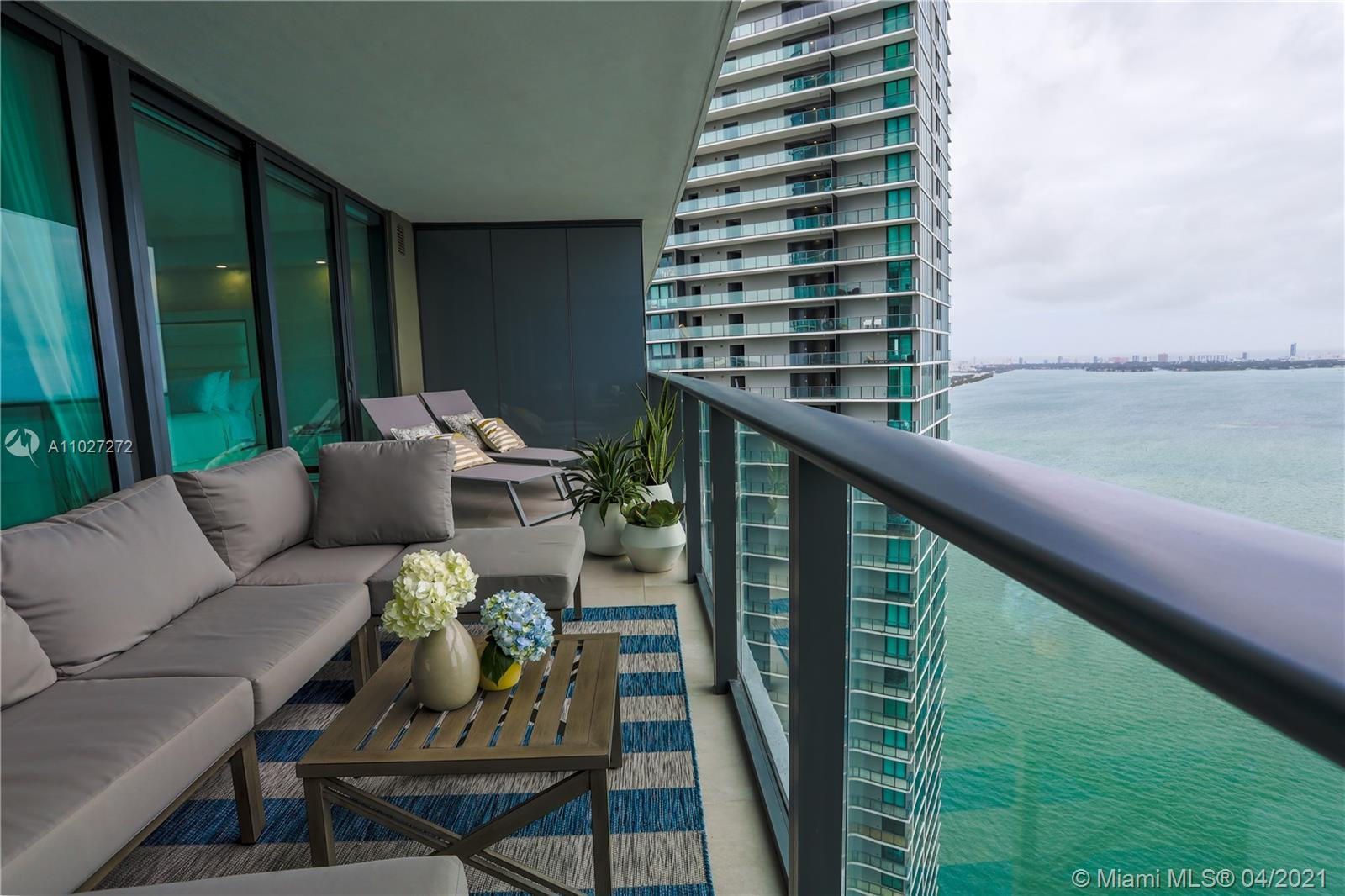 Stunning unit sitting in the heart of Edgewater! Open floor plan, island kitchen with modern stainle
