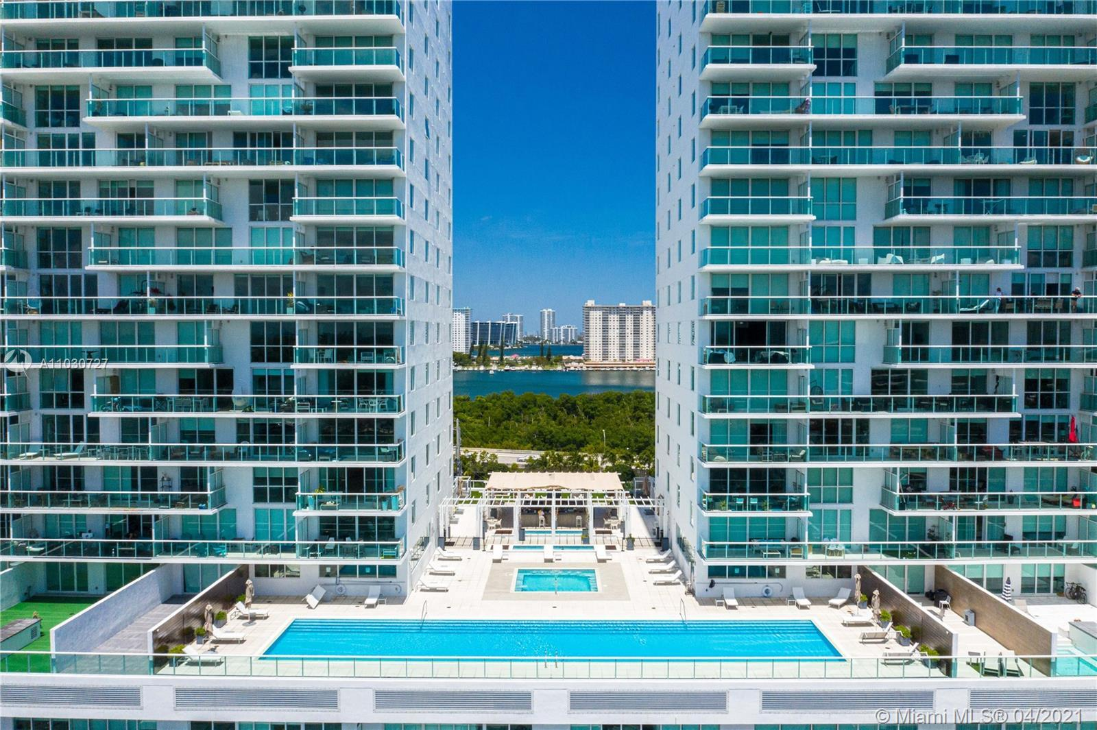 VISUALLY STUNNING DESIGNER UNIT IN A PREMIER WATERFRONT PROPERTY. FEATURES INCLUDE- 180 DEGREE INTRA