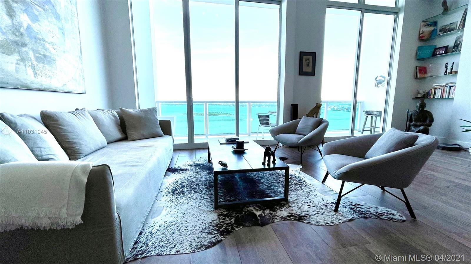 Unique and spectacular loft with unobstructed bay and ocean view. High ceiling (13 feet) and floor t