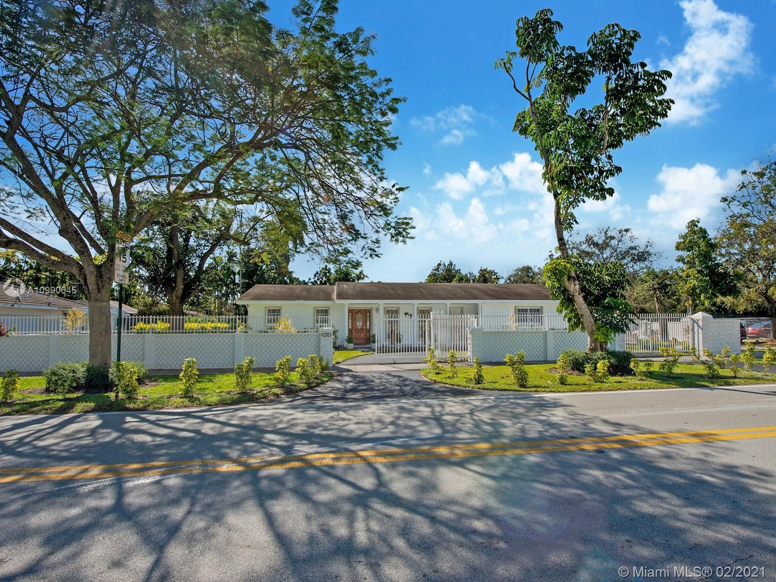 Meticulously cared for and upgraded home. Situated on a manicured gated corner lot with a circular d