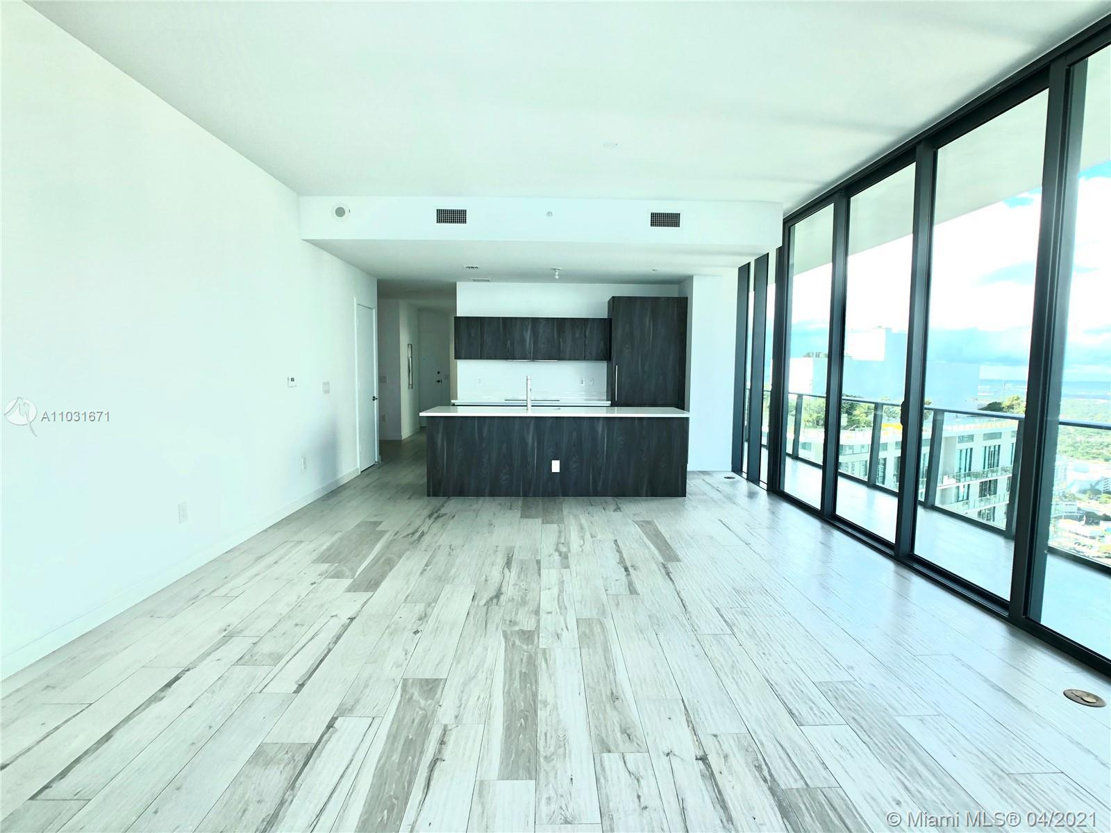 Breathtaking flow-through, 3 bedrooms & 3 bathrooms + Den waterfront unit with private elevator and