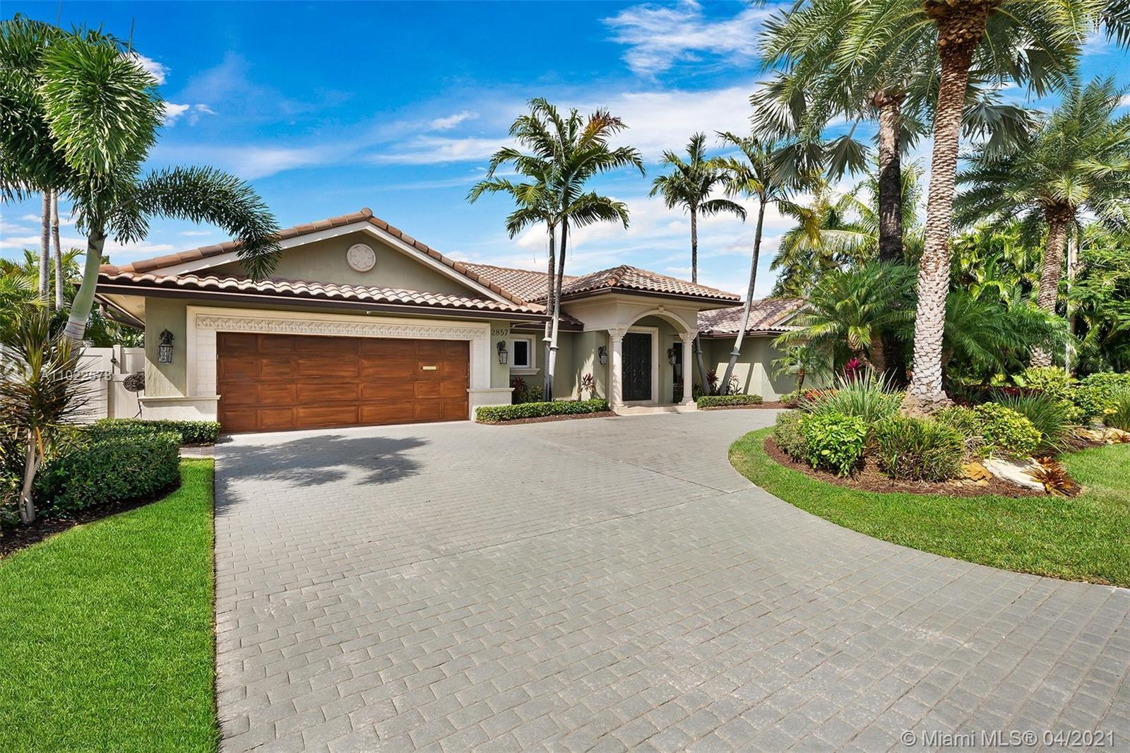 Gorgeous waterfront single story home in prestigious Coral Ridge.  This rare property has a wide ope