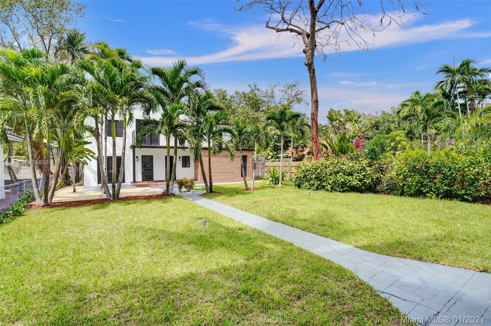 Investor opportunity or ideal 2-family residence. Tropical-modern duplex set on a gated lot in S. Co