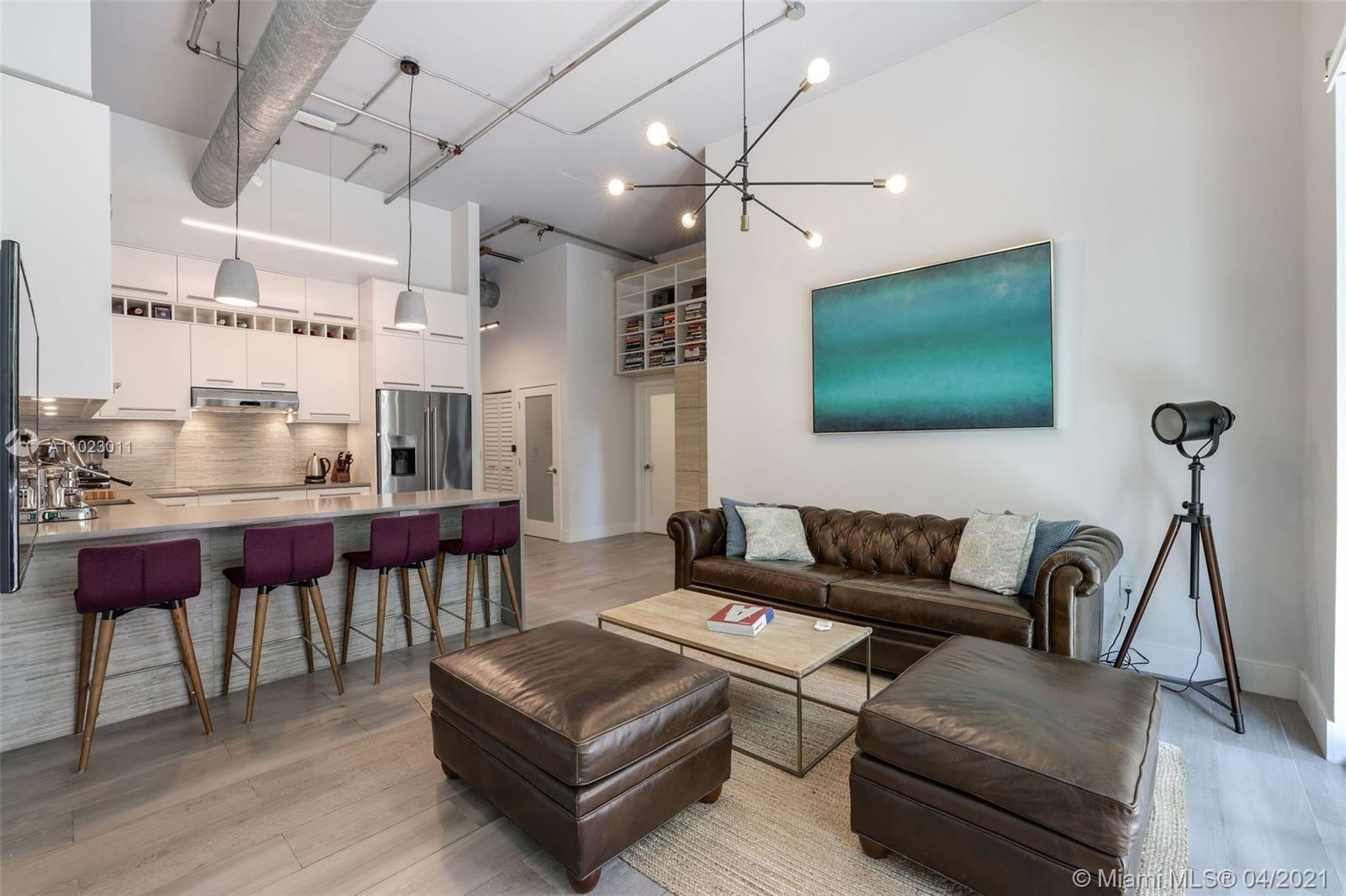 "Tastefully renovated loft in the heart of Miami. Ground floor unit with soaring 12'6"" ceilings. Spli"