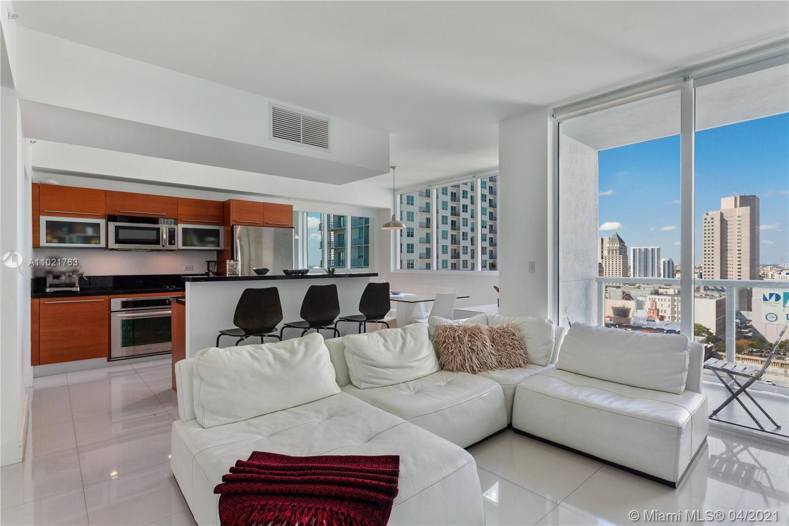 Large 1 bedroom + Den converted into a 2 bedrooms 2 baths. Corner unit in the Heart of Downtown Miam