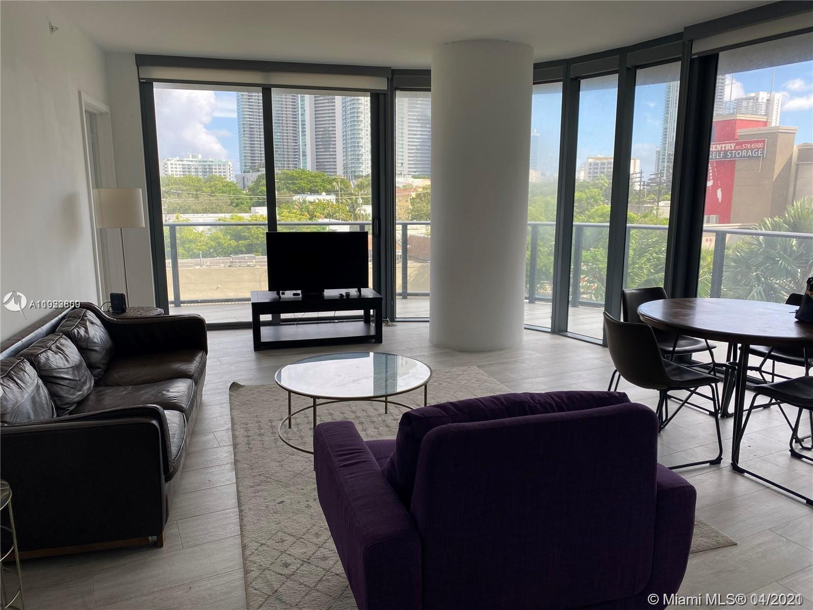 CORNER UNIT WITH WRAP-AROUND BALCONY. BREATHTAKING VIEWS TO THE OCEAN, SOUTH BEACH AND DOWNTOWN SKYL