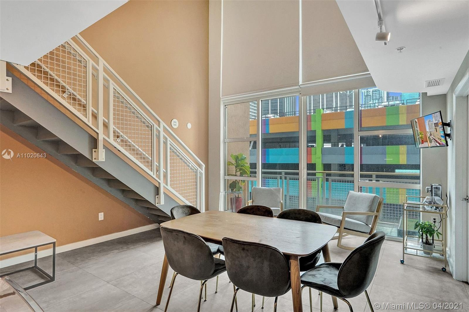 Exclusive two-level loft in the heart of Miami for sale! This fully furnished, beautiful, modern and