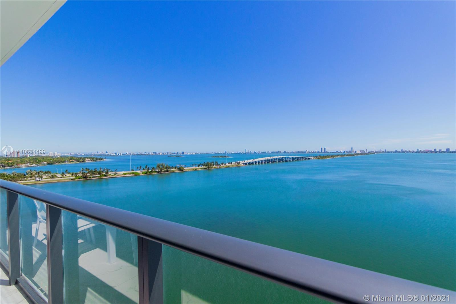 Enjoy breathtaking panoramic views of Biscayne Bay and Miami's skyline from this luxurious unit in t
