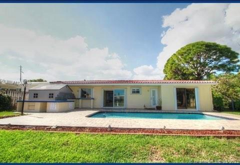 Reduced, motivated seller. This quintessential South Floridian home is a spacious, brightly lit wate