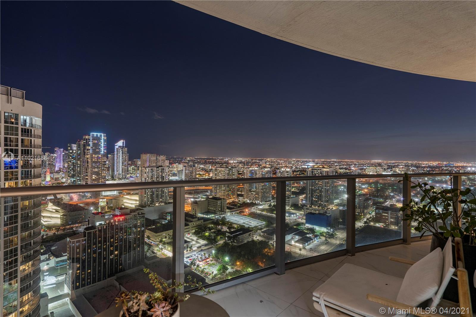 Highly sought after building in the heart of Edgewater. This amazing unit has Bay views from every r