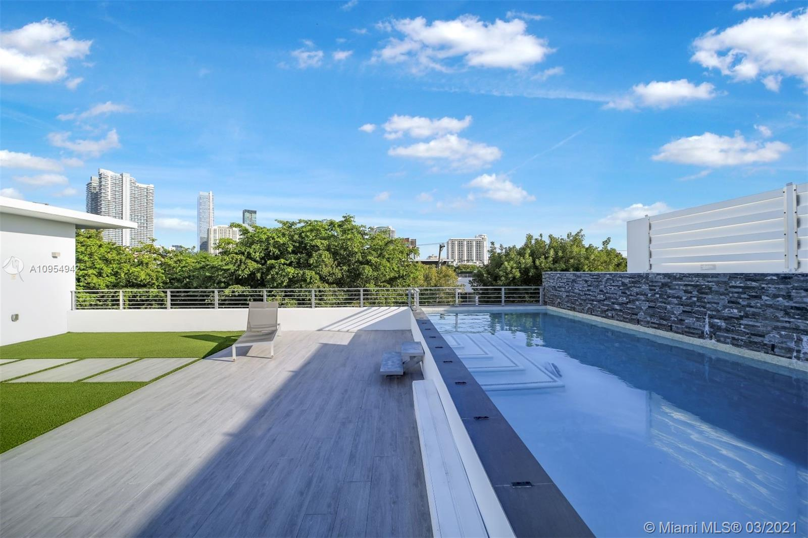 Total square footage: 3,827 square feet including second floor balcony and garage. Brickell Broadway