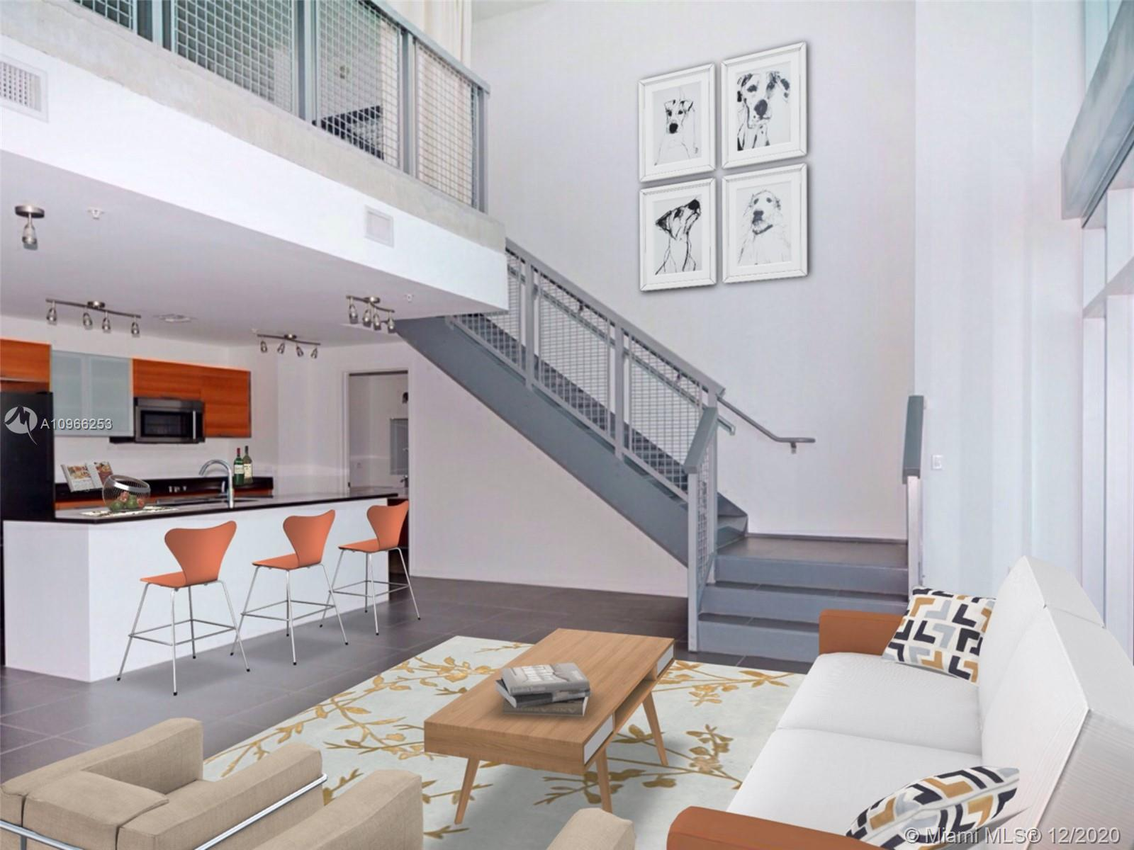 Stunning one bedroom plus den duplex loft at coveted 4Midtown with soaring 30 ft ceilings filled wit