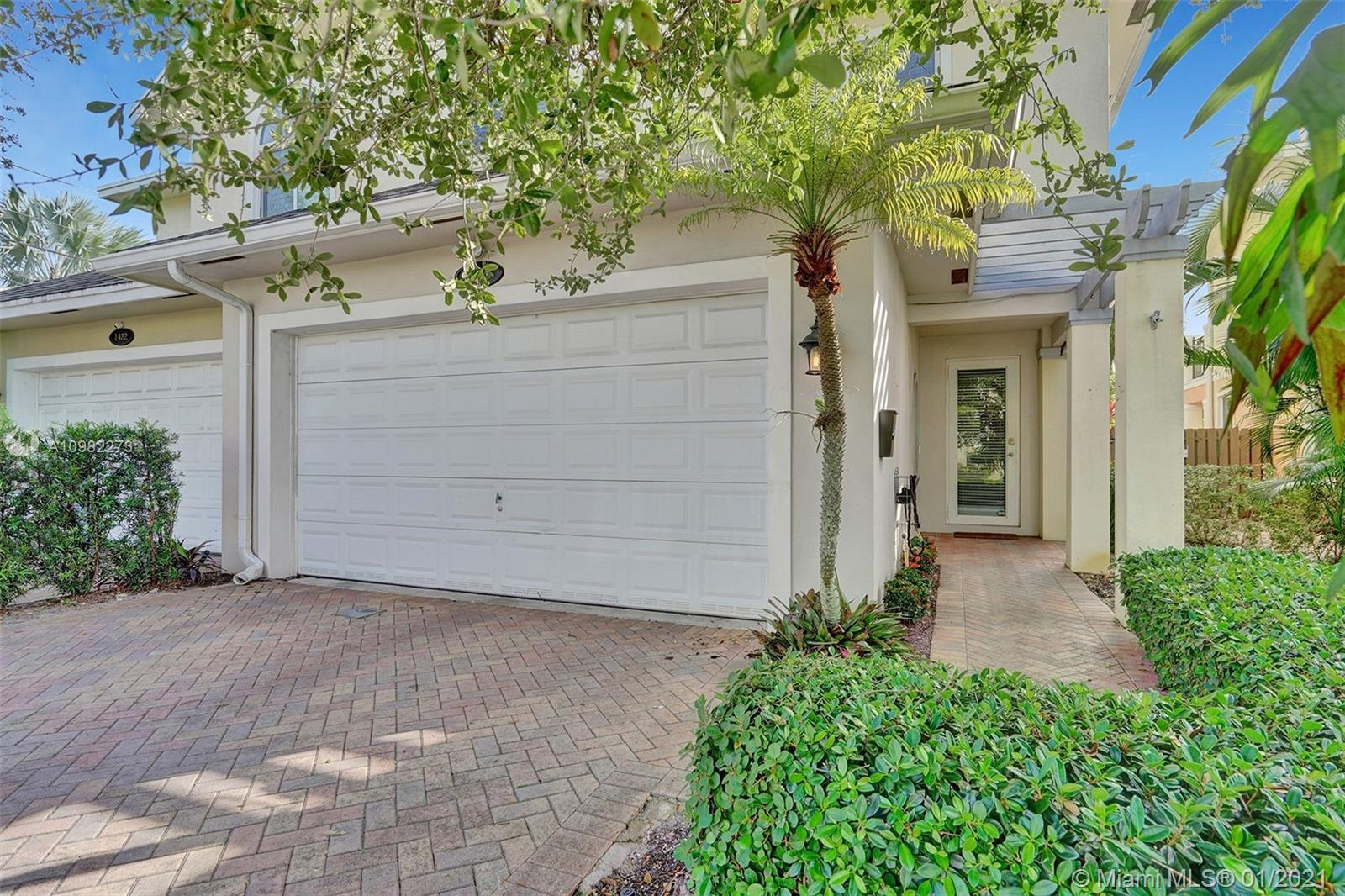Gorgeous townhome that is not governed by HOA. Modern kitchen and granite breakfast bar open to grea