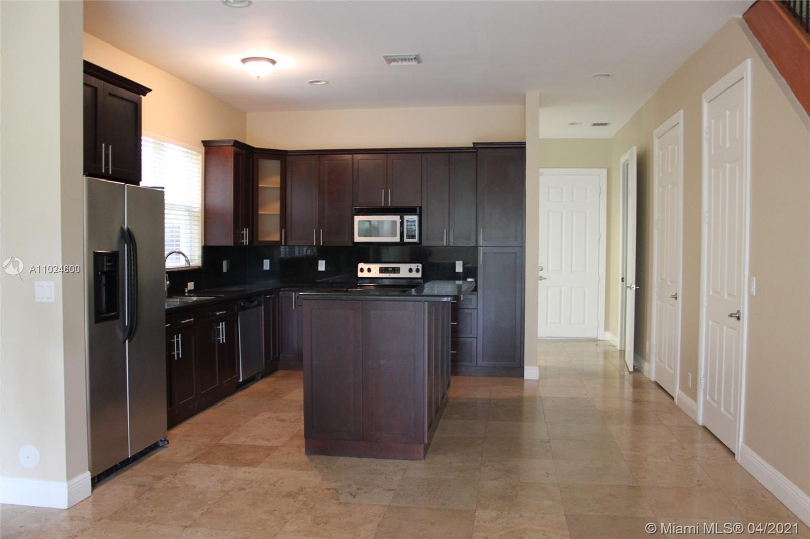 2-story Townhome, Gourmet kitchen with granite countertops, stainless steel appliances.Marble floor