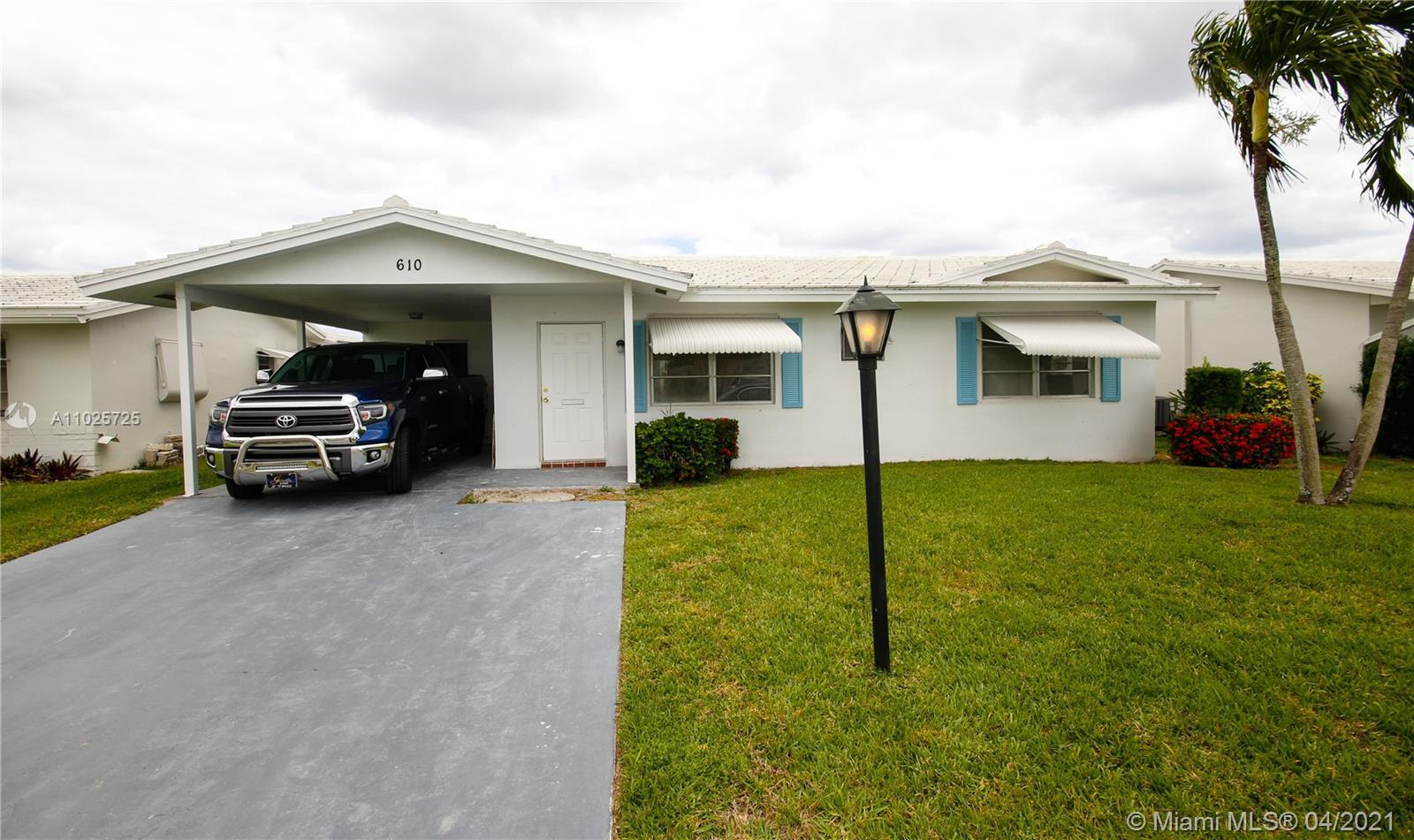 Here is your dream/completely remodeled 3/2 w/carport villa right across from the community's 18-hol