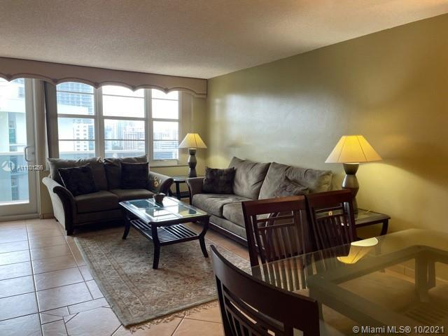 TURNKEY LARGE UPDATED 2 BEDROOM/2 BATH FABULOUS APARTMENT WITH VIEWS OF OCEAN AND STREET. OPEN KITCH