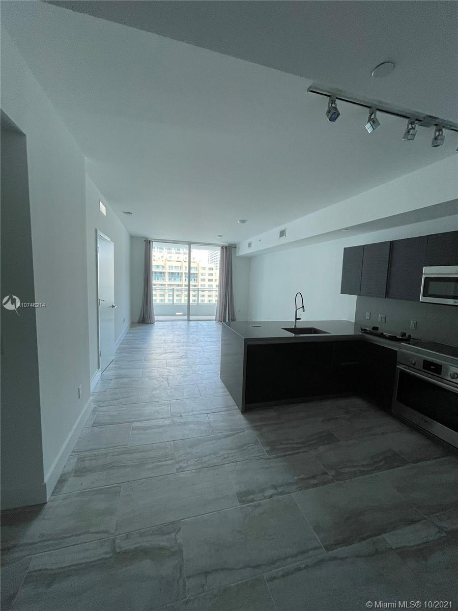 Almost new 1 bedroom apartment with large den which can easily be converted into second bedroom and