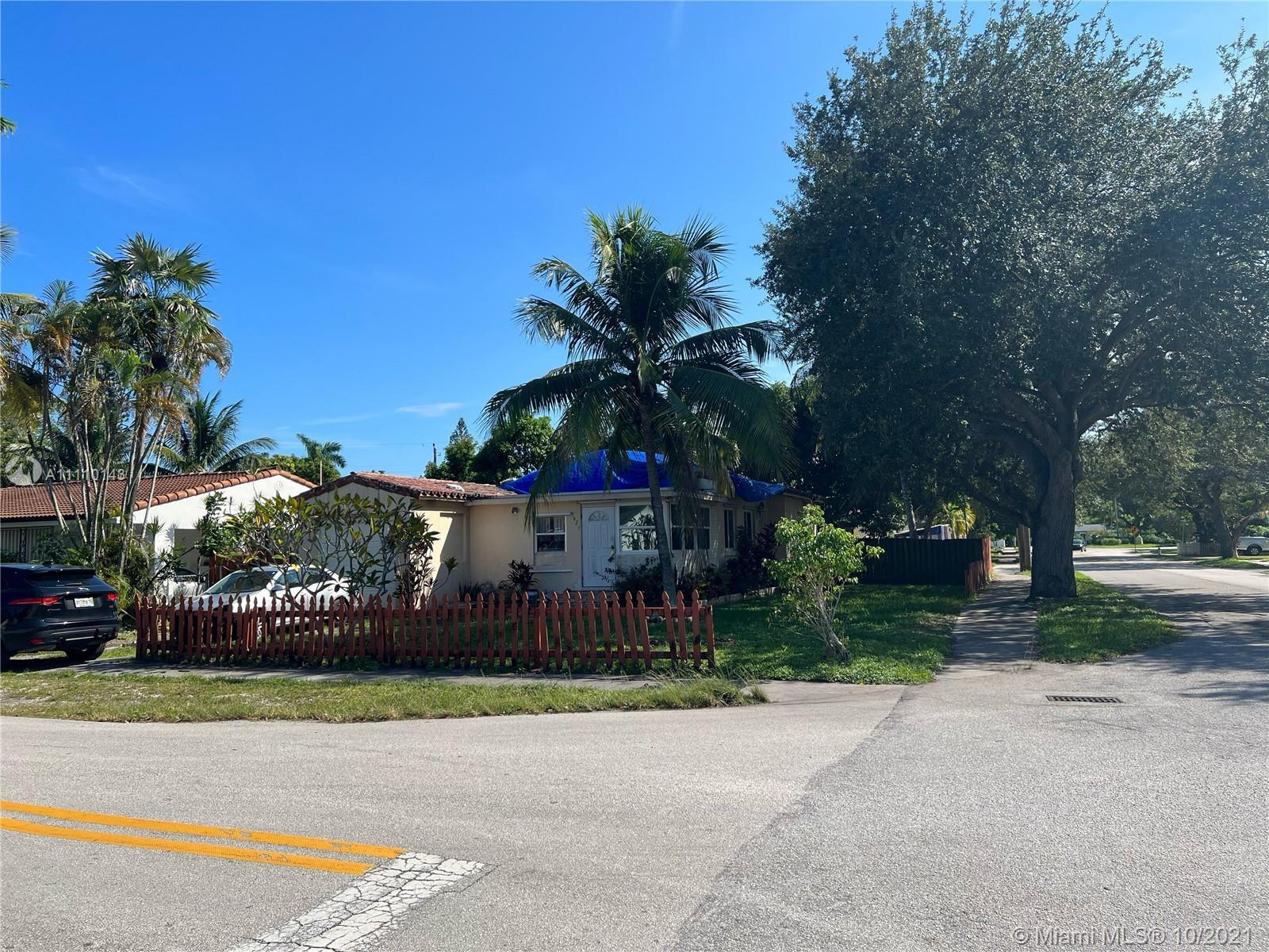Property needs a new roof and lots of TLC. Large Corner property located in the center of Hollywood,