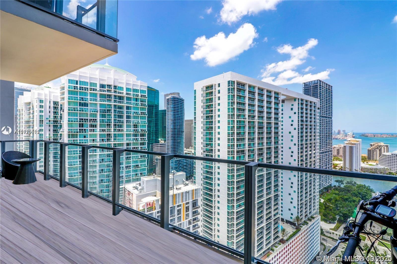 UNIT WITH SPECTACULAR INTER COASTAL AND BRICKELL SKYLINE CITY VIEWS. UNIT FEATURES 2 BEDROOMS, 2.5 B