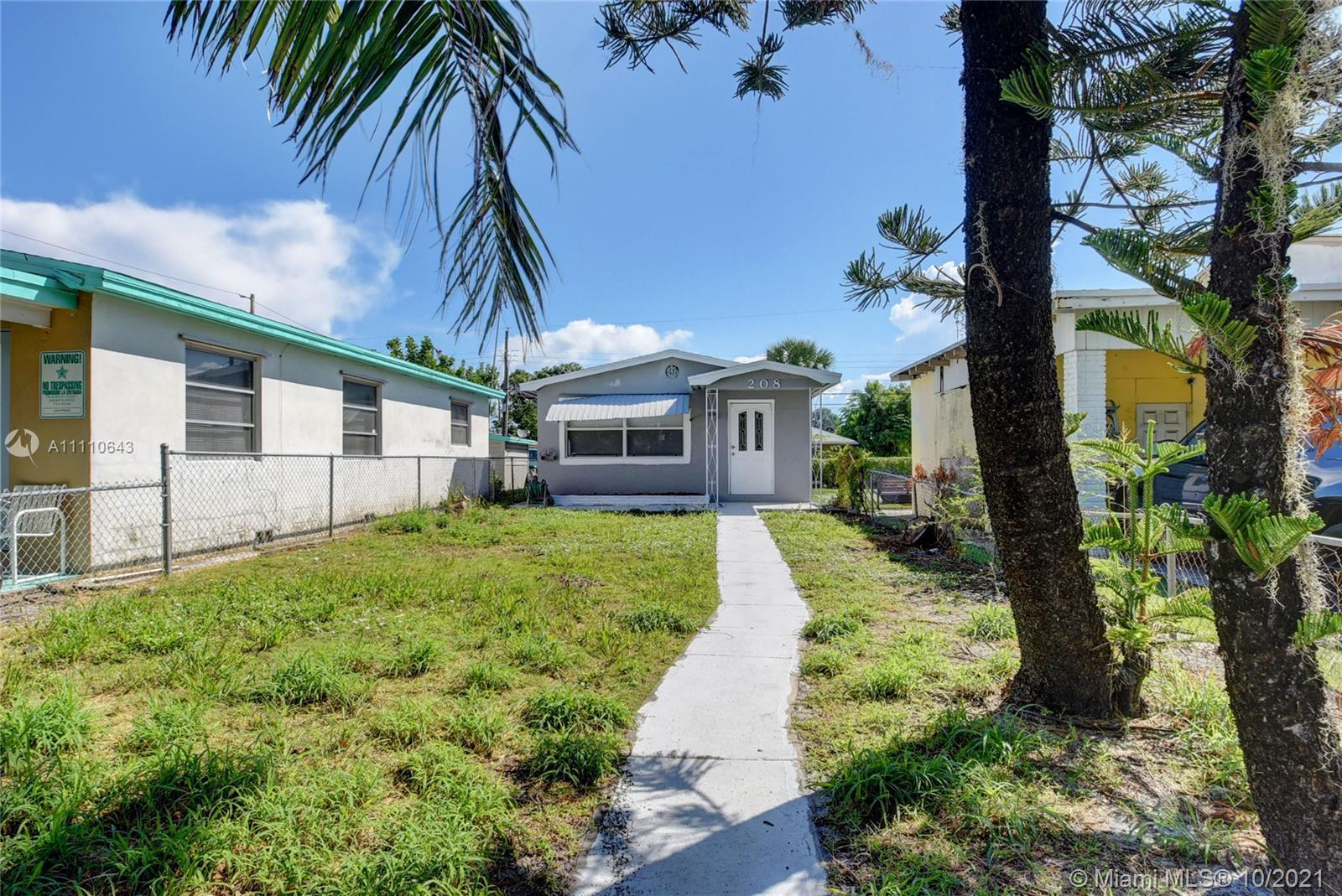 Beautifully remodeled 2 bedrooms 1 bathroom home for sale. Modern eat-in kitchen with quartz counter