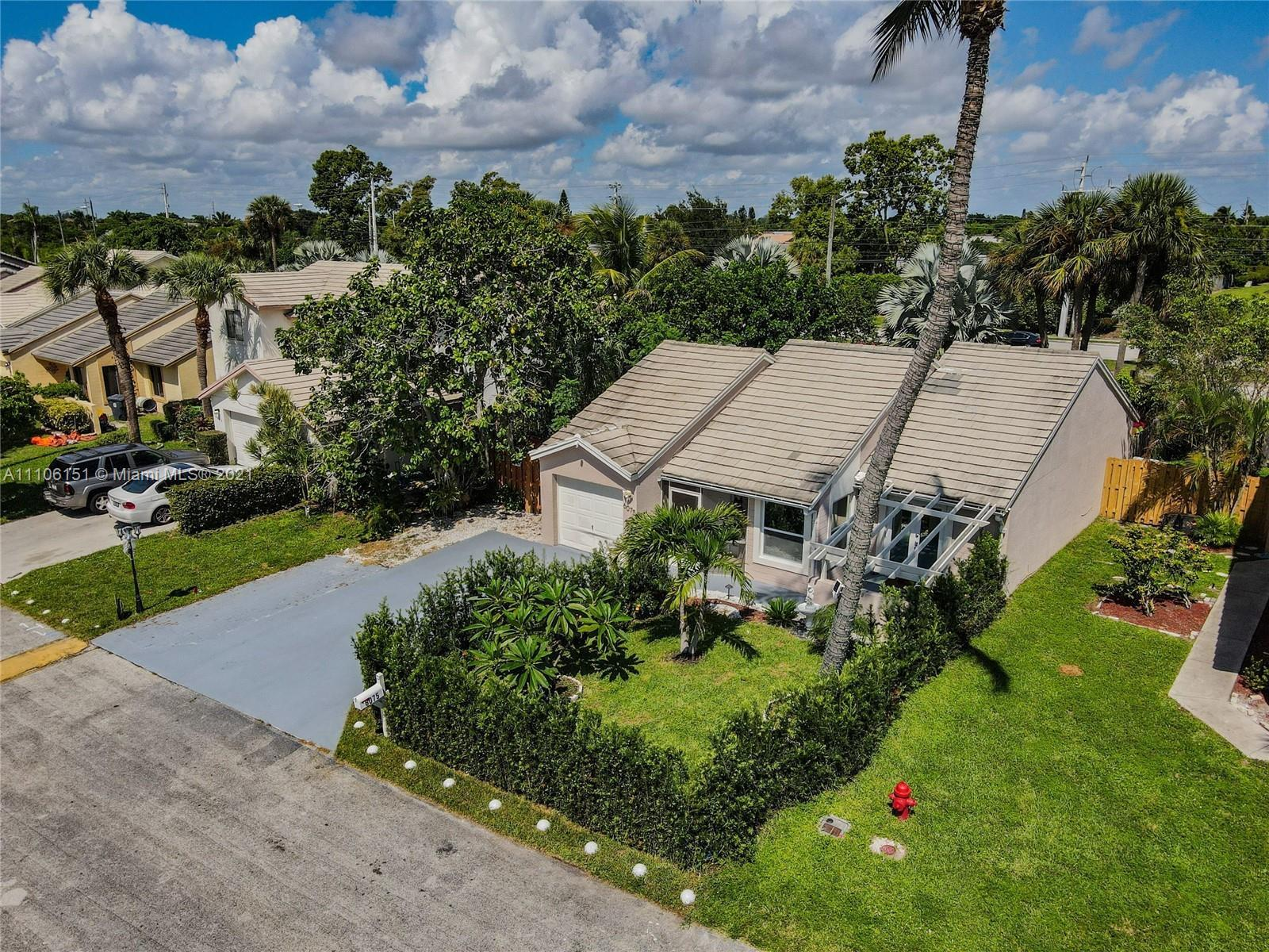 This is a True Gem! Amazing Smart-home in Lake Worth, featuring a Screened Pool, 4 bedrooms, 3 bathr