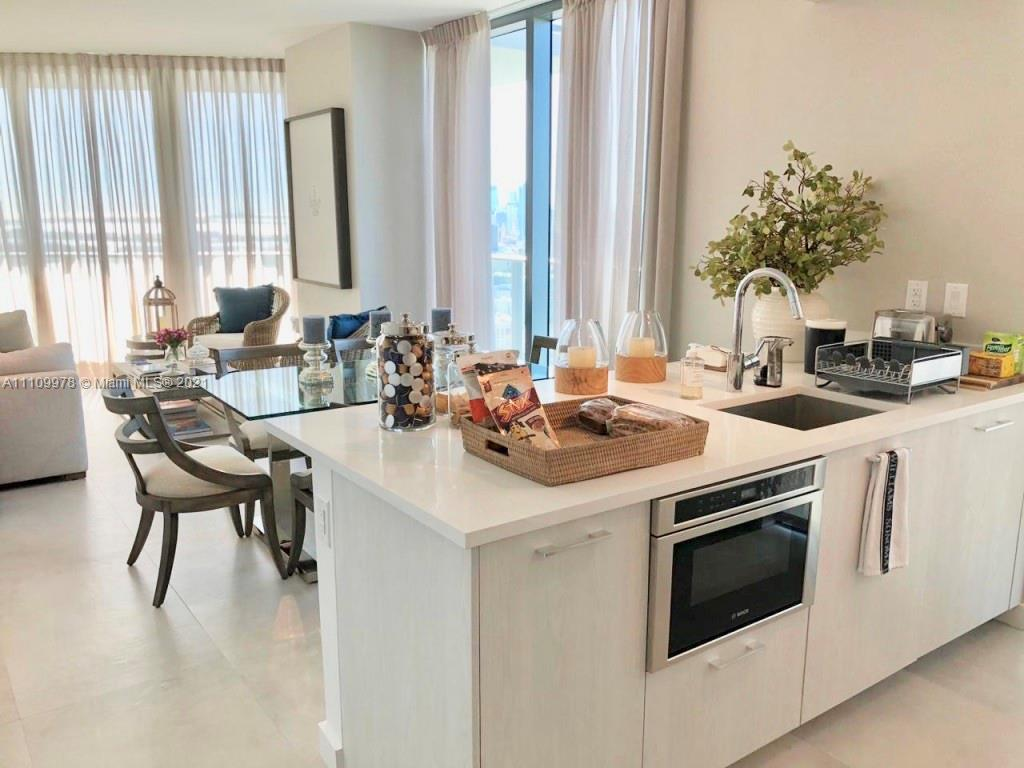 This 2 bedroom + den unit is perfectly suited for those who want to live in Miami. It has all the co