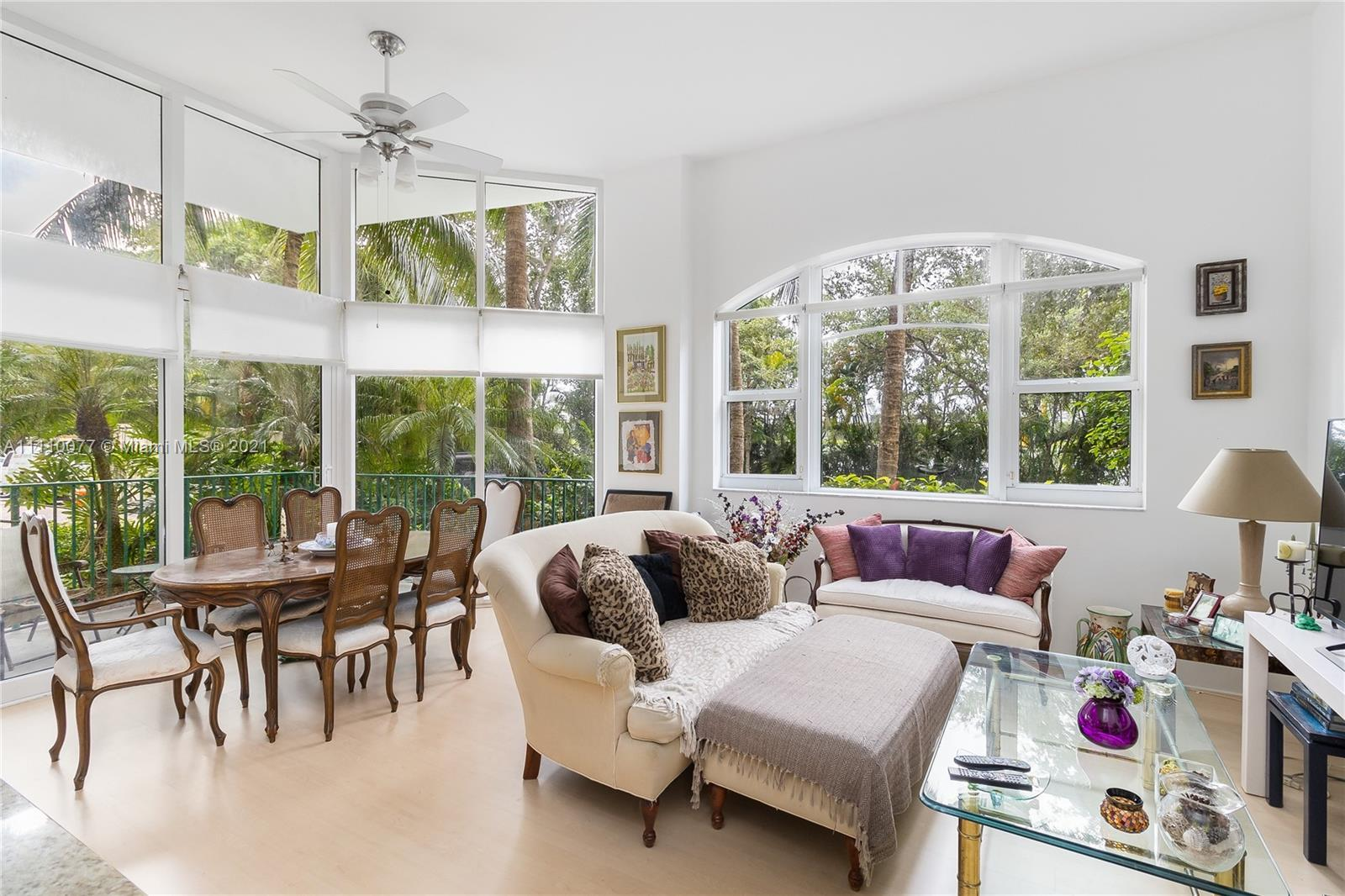 This condo feels like you're living in a house! Incredible open living space with 14ft ceilings and