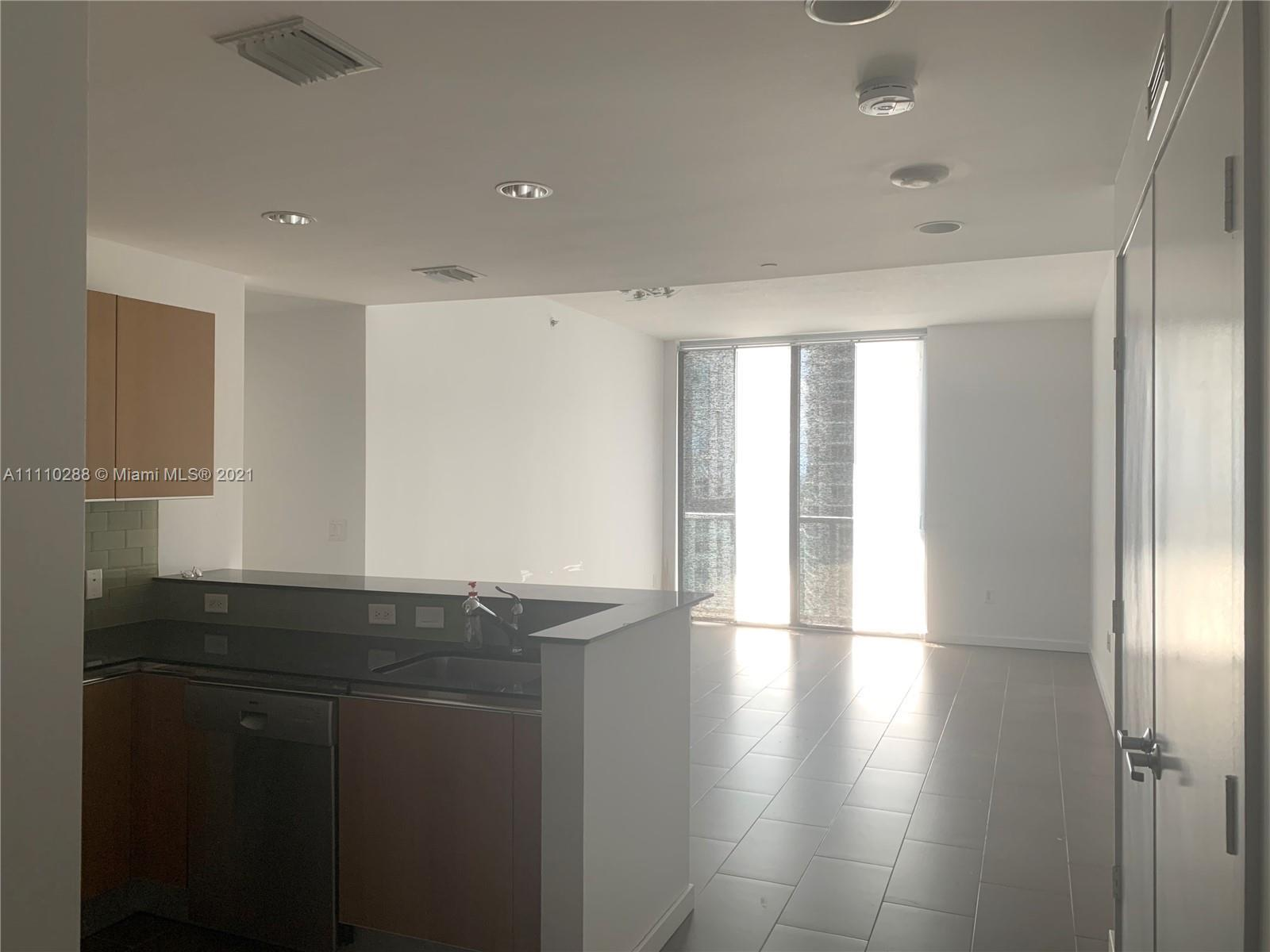 Beautiful 2 bed 2 bath corner unit in the exclusive 1060 Brickell Condo offering floor-to-ceiling hi