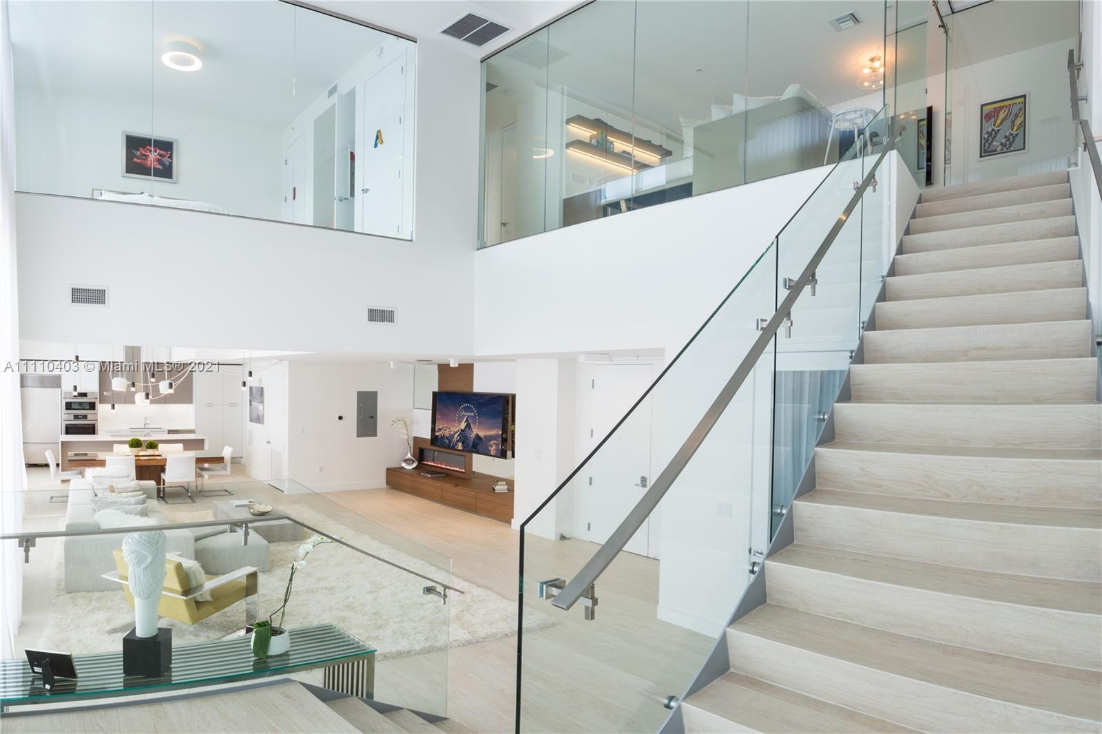 A must-see spectacular 2-story penthouse in the heart of Midtown Miami. This 2 BED + DEN (2,129 Sq.F