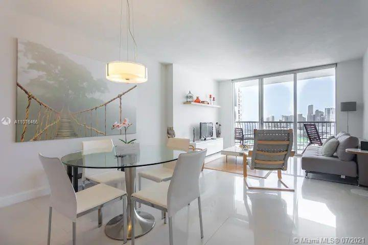 Enjoy the beautiful Bay and City views from  this 1/1 furnished unit with marble floor, stainless st