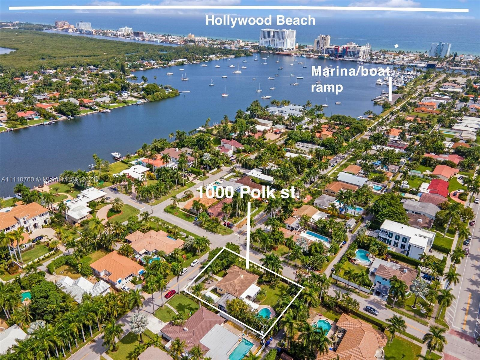 This four bedroom, two and one half bath home boasts a pool, large enclosed porch and space for boat