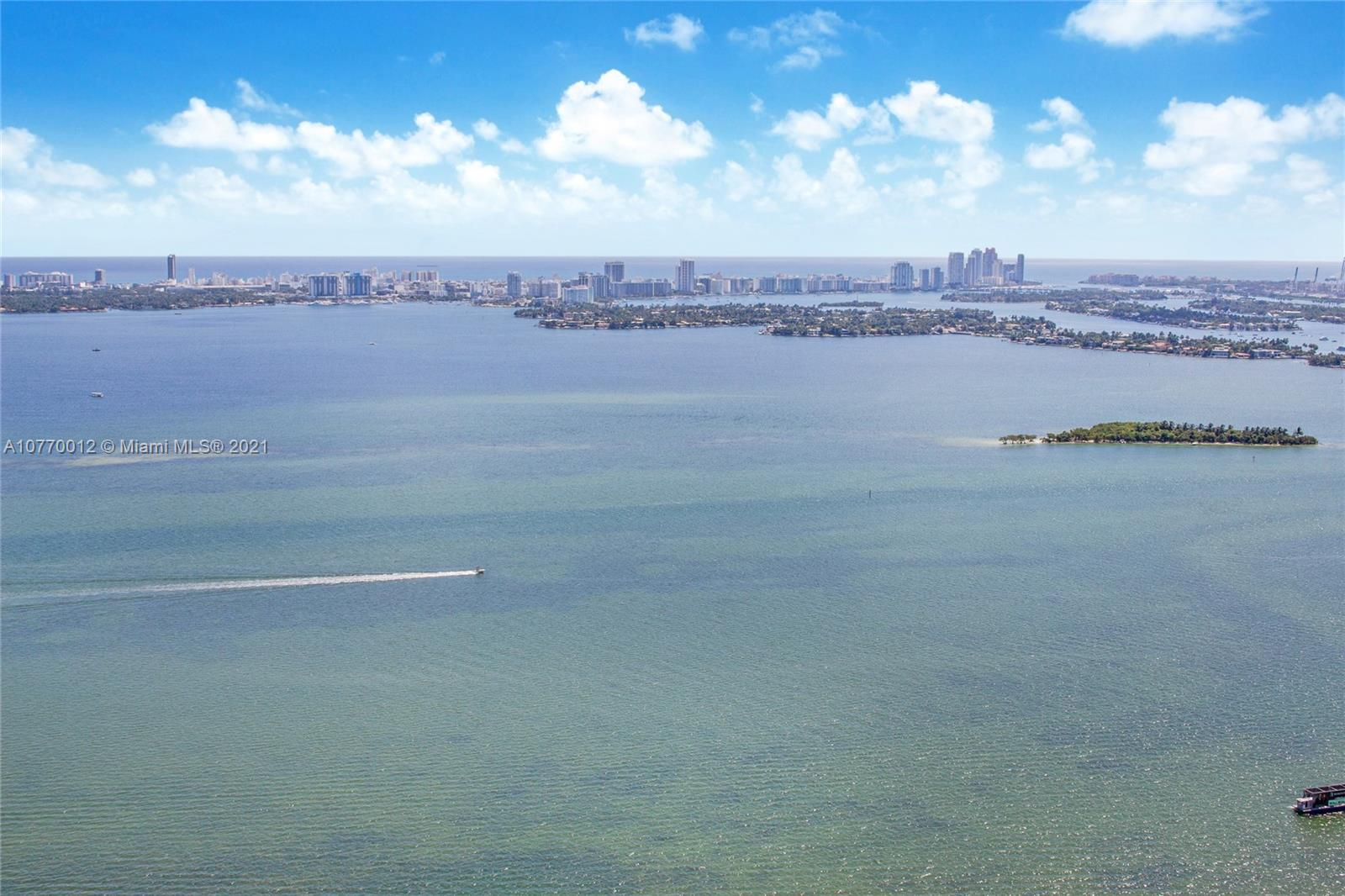 NE corner Penthouse: 4/4.5 + Den; 3182 SF; panoramic bay views. The staged photos create  a contempo