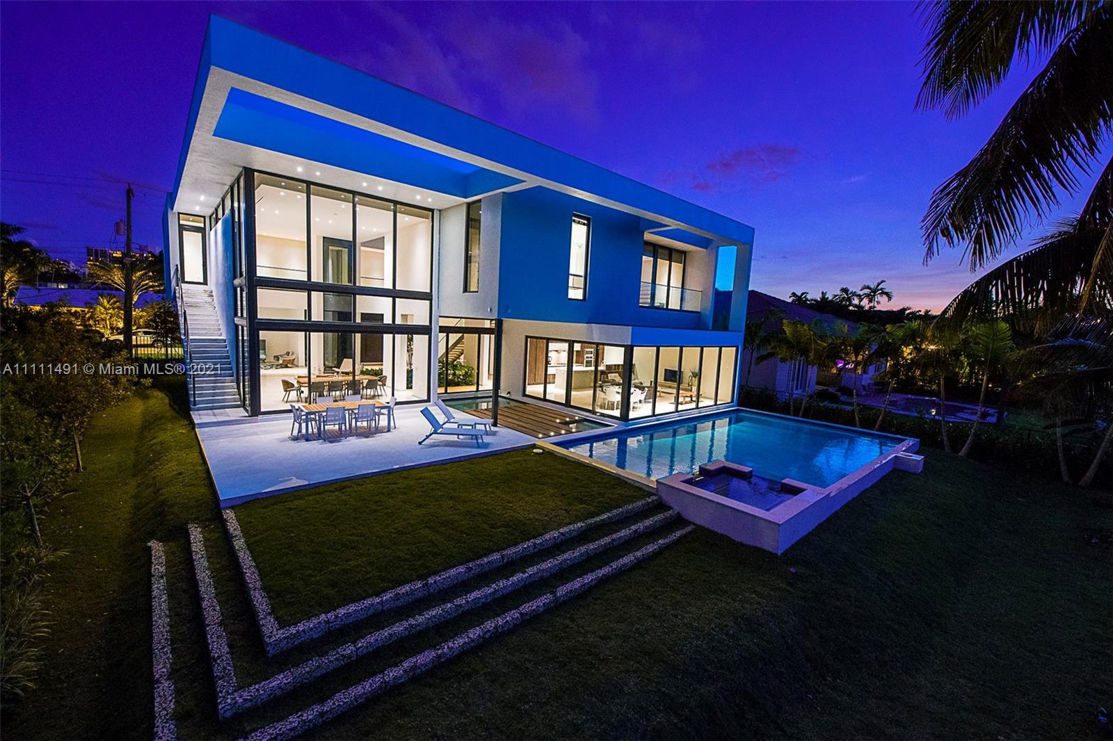 Located in the exclusive Golden Isles community, this architecturally stunning waterfront home displ