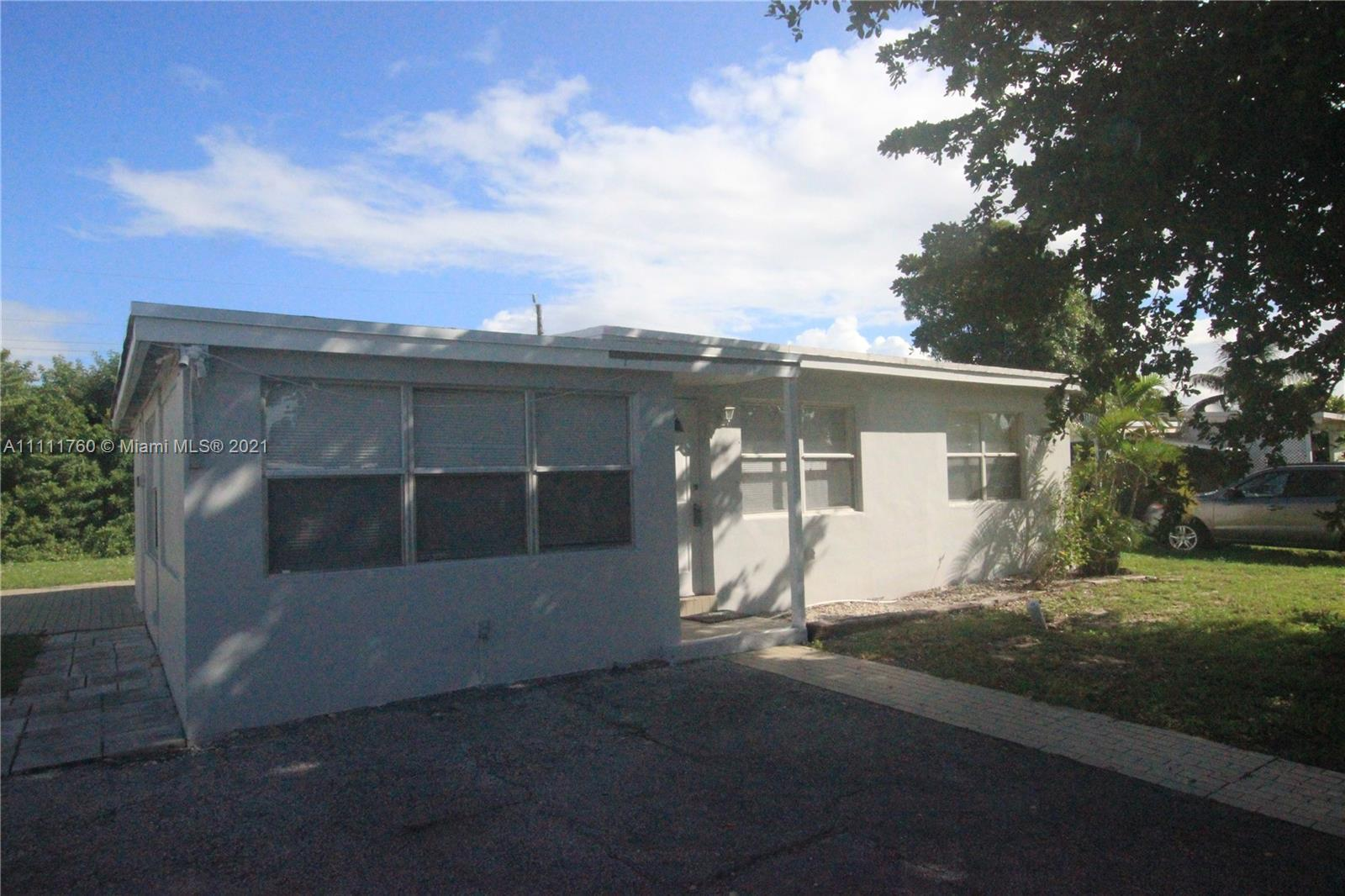 3/1 with Granite countertops, new kitchen cabinets, new flat roof and more.  Great home and priced t