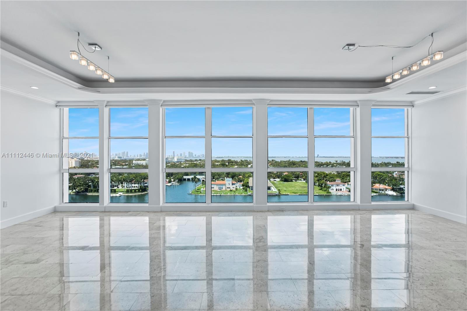 This one of a kind unique and spacious 4BR/4BA Penthouse features floor to ceiling windows throughou