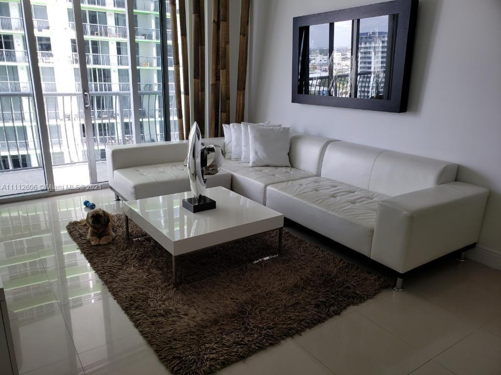 SPACIOUS 1 BEDROOM 1 BATH UNIT AT ICONIC OPERA TOWER.  SPACIOUS BALCONY WITH GREAT CITY AND BAY VIEW