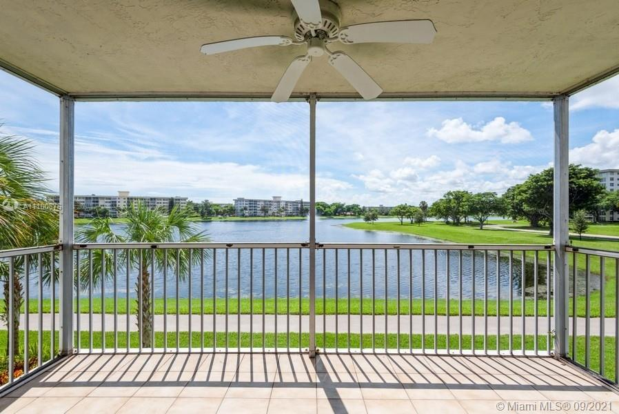 Direct water views of Palm Aire's largest lake and easy access to recreation path. Spacious, superio